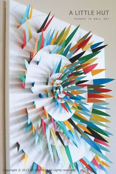 Paper Scrap Wall Art Draw a spiral on a large piece of paper, glue triangle of scrap paper on and glue to a foam board... description on pinterest.  8th grade