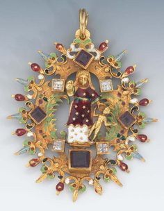 A Victorian Renaissance Revival Religious Pendant. 3 x 2-½ in. Yellow gold pendant featuring mother and child in the center, within a fancy scroll and flour de lys pattern, decorated in polychrome enameling on the front and back, set with red and clear stones; overall weight 55.8 gm.