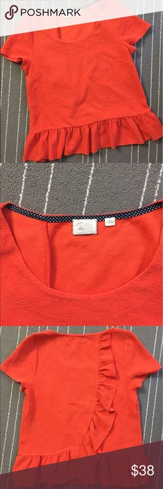 """Anthropologie postmark beautiful orange blouse Very beautiful blouse with ruffles on the bottom and back side. Bust is about 19"""". And length is about 23"""". 97% cotton and rest polyester. Previously loved and worn. Anthropologie Tops Blouses"""