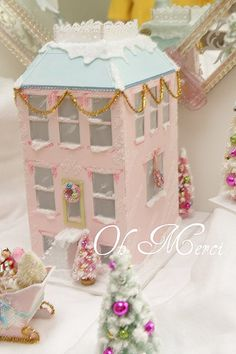 Beautiful pink Christmas townhome house /building with blue & white roof and pink bottle brush trees by Oh Merci. Christmas In The City, Pink Christmas Tree, Shabby Chic Christmas, Noel Christmas, All Things Christmas, Vintage Christmas, Christmas Crafts, Christmas Decorations, Holiday Decor