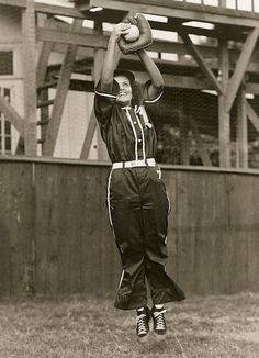 Grace White makes a catch during a game with her softball team from the Hawaiian island of Oahu.