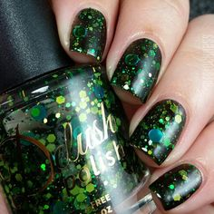 A Very Neat Monster is a black jelly polish with an array of green, neon glitters and large holographic dots!