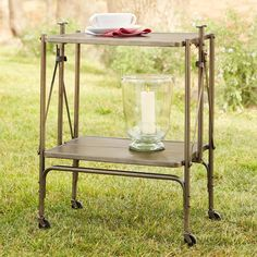 """CARTWRIGHT FOLDING CART--The uses are many, the character is non-stop, and the cleverness has us smiling—a folding cart, set on rolling casters. Iron with gunmetal finish. Imported. Exclusive. 23""""W x 16""""D x 30""""H."""