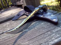 'This is a RplRaven forged Railroad spike knife and custom sheath. Hand forged by me , form high carbon railroad spike,it has nice file work on the top.' ( note above is from ad on etsy) One of a kind piece that was on etsy. com ... Too bad it was sold lol