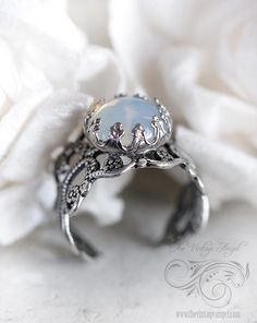 Moon Opal Ring. This is a great design. If I custom make my ring, I will do something like this.