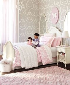 I'm pulling ideas together for a 5-year old princess fanatic's bedroom.  This is a nice spin on the princess theme - silver-gray walls with pink accents.  So wall color - check!