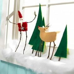 Use a window sill to capture this scene straight from the North Pole -- Santa hanging out with his reindeer pal on a snowy landscape. The twig-and-felt figurines are held together with hot glue, but with this easy-to-make project, you can sub in crafts glue and make it with kids. Instructions http://www.bhg.com/christmas/crafts/crafty-christmas-scene-made-from-wool/