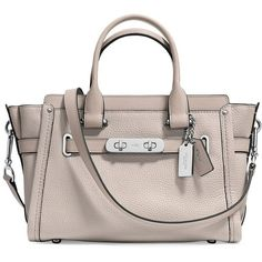 COACH Swagger Pebbled Leather Satchel (2.390.400 IDR) ❤ liked on Polyvore featuring bags, handbags, structured purse, brown satchel purse, handbag purse, brown hand bags and brown purse
