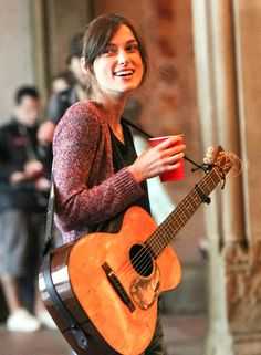 The multi-talented #KeiraKnightley makes some music on the set of 'Can a Song Save Your Life?' in #CentralPark in New York City on July 20, 2012.