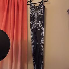 Never worn blackmilk clothing skeleton catsuit. Blackmilk Skeleton catsuit, never worn. I'm a 12-14 with a 38DD chest, it was just a little snug for me. Size L perfect condition. Sold out online Blackmilk Other