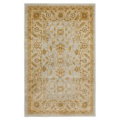 Anchor your dining set or living room seating group in classic style with this elegant rug, featuring a Persian-inspired motif in light gray and gold.