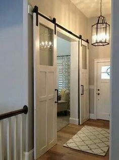 Like the doors to help keep the cold out. I think that this may be perfect for nook to playroom opening Sliding Barn Door Hardware craftsman entry Interior Flat, Interior Barn Doors, Modern Interior, Interior Design, Scandinavian Interior, Interior French Doors, House Paint Interior, Luxury Interior, The Doors
