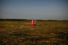 A vending machine, brought inland by a tsunami, in an abandoned rice field in Fukushima
