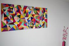 this was a diy project...painted triangles on a huge canvas. Looks a bit like the Love Chic Living logo!