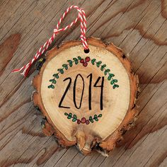 Hand lettered wood slice ornaments by Itty Bitty Bunnies