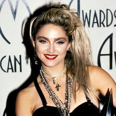 "MADONNA - 1985 ""This was the Like a Virgin era,"" makeup artist Gina Brooke has said of Madonna's American Music Awards look. ""She laughs about how she did her own makeup."""