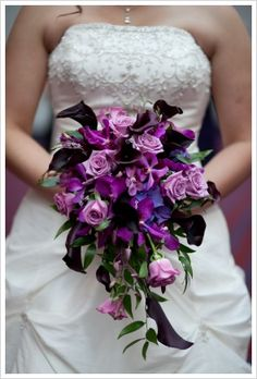 A mix of purple flowers in this bouquet. Use purple roses, black calla lilies, blue hydrangeas and purple orchids to make an intense look bouquet.