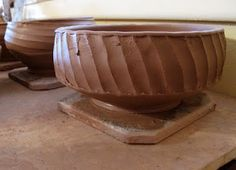 Facet/carve the sides then belly the bowl out