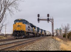 CSX junk freight Q394 roars under the classic C&O cantilever in the small community of Lemoyne, Ohio with CSX SD70ACe # 4849 in charge on  3-25-17