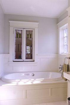 board & batten paneling; pretty stained glass window