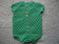 Instructions for a reborn or baby vest set in DK yarn. The set comprises of a button up and under vest, beanie hat and socks in a lacy eyelet pattern. When knitted this set will fit a 0-3 month old baby or 21-22 inch reborn doll. You will need 150g double knitting yarn, 3.25mm needles, 4mm needles, 5 stitch holders and 13 buttons. This pattern is only available in Knitting Pattern Book 1 with its sister patterns No. 10 and No. 11