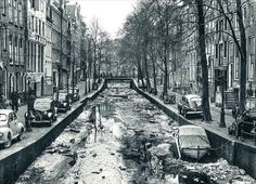 1950. View on a contaminated Oudezijds Achterburgwal in Amsterdam. #amsterdam #1950 #oudezijdsachterburgwal