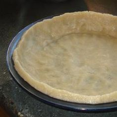 """I found this recipe by google-ing """"easiest pie crust recipe ever"""" when I didnt have time to make my Grandma's amazing pie crust. SO EASY and it was great! You dont have to roll it out or anything, just mix up the ingredients in the pie pan and press down!"""