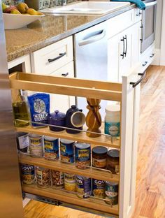 37 DIY Hacks and Ideas To Improve Your Kitchen    Narrow Roll Out Rack for Cans  via WooHome