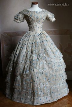 Ballgown in full taffeta ivory silk veil covered with ivory embroidered blue flowers and blue. c. 1852