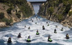 Participants of a jet ski tournament ride through Corinth Canal, connecting the Peloponeese with mainland  Greece