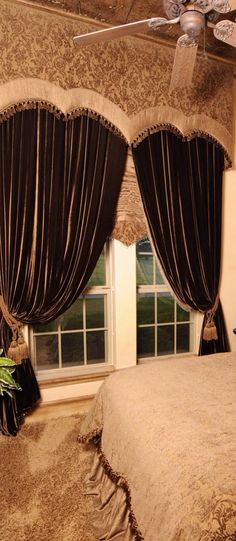 Scalloped upholstered cornice and full draperies.