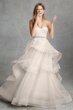 Monique Lhullier Strapless sweetheart natural waist ballgown wedding dress with signature asymmetric horsehair peplum.