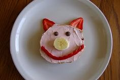 Cute Farm Theme Snack, or the three little pigs (which is our theme this week) bagel, strawberry cream cheese, rasin eyes, banana nose, red pepper mouth, strawberry ears