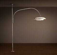 RH's 1970S Italian Tension Pole Lamp:Designed to span the full height of a room, this tension pole lamp captures the bold style of the 1970s Italian fixture that inspired it. Like the original, it has an adjustable pole and a curving arm that raises and lowers for customized lighting. An oversized head with a metal diffuser inset casts warm, bright light.