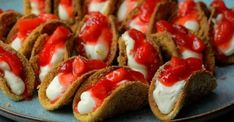 No time to make a full cheesecake? These mini strawberry cheesecake tacos are th& No time to make a full cheesecake? These mini strawberry cheesecake tacos are the perfect solution. They& bite sized, shareable and taste like cheesecake! Dessert Parfait, Bon Dessert, Taco Dessert, Dessert Shots, Mini Strawberry Cheesecake, Strawberry Recipes, Mini Cheesecake Bites, Mini Strawberry Shortcake, Mini Cheesecake Recipes