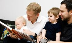 Fathers reading a book to their children Sweden.