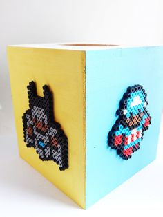 Black Superhero Wood Tissue Box The tissue cover box is a large wood hand painted with perler bead superheroes attached. The box is has four different color sides, yellow, green, blue and white. The box has four Black Superheroes on it, The tissue box is 5 cube that sits approx. 6 high.   Shipping ******************************************************** All shipping options are available. All items will be shipped out Monday through Friday. Receipts will be emailed out for immediate access…