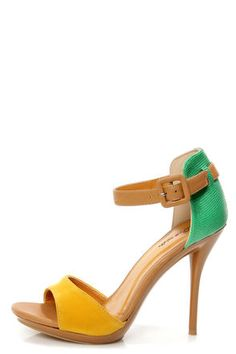 The Promise Quillan Yellow and Green High Heel Sandals are THE way to rock the color block, with a vegan split upper in mustard yellow suede and snakeskin-textured, green vegan leather! High rise heel cup reaches up above the ankle for a sophisticated touch, with a tan, vegan leather, wraparound ankle strap that adjusts with a cute covered buckle (and hidden elastic). Barely-there, shiny tan platform adds just under a 1/2