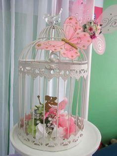 Birdcage - could do something similar with fairies, butterflies and flowers. For use as centerpieces on guest tables
