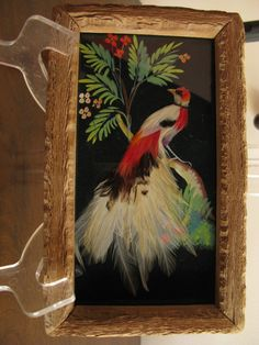 You either love these things ... or you dont. I have three of these Mexican Folkart Feathered Bird Pictures offered. As with all of this kind,