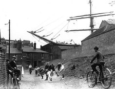 Inch Print - High quality prints (other products available) - Children playing a game of leap-frog near Millwall Docks, underneath the bowsprit of the schooner & - Image supplied by Fine Art Storehouse - Photograph printed in the USA London History, British History, Vintage London, Old London, East End London, South London, Millwall, Isle Of Dogs, London Pictures