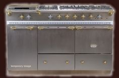 OMG....this french range in stainless steel with brass trim is TO DIE FOR.   It is made by CLUNY....a french company in France.   THIS IS MY DREAM RANGE!