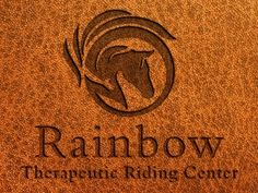 A custom horse logo design created for the Rainbow Therapeutic Riding Center. Shown embossed on tan-brown leather. Horse Logo, Custom Logos, Brown Leather, Logo Design, Rainbow, Horses, Rain Bow, Rainbows, Horse