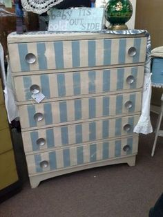 $135 -  This dresser has been painted a creamy white with blue striping. It has been lightly distressed and has original metal hardware. It measures 34 inches across the front, 16 inches deep. The dresser stands 42 and a half inches tall. It can be seen in booth D 8 at Main Street Antique Mall 7260 East Main St ( E of Power Rd ) Mesa 85207  480 9241122open 7 days 10 till 530 Cash or charge 30 day layaway also available
