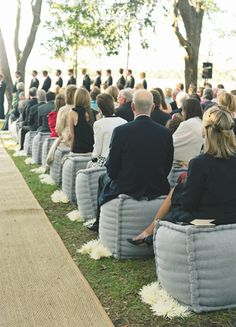 Padded ceremony seats for guests // Photography: Liz Banfield Photography // Event Planner: Tara Guérard // TheKnot.com