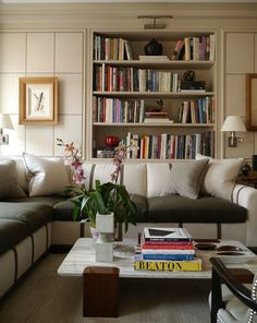 Library by NY Designer David Kleinberg-tradition with modern touches, features linen-paneled walls with nailhead trim in a grid pattern. Large sectional marries form and function, also doubles a queen size pull-out bed. Living Area, Living Spaces, Living Rooms, Bookcase Styling, Ideas Hogar, Interior Decorating, Interior Design, Decorating Ideas, Home Libraries