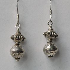 "Sterling silver earrings. Sterling silver beads on sterling silver french hook ear wires. 1 1/2"" long."