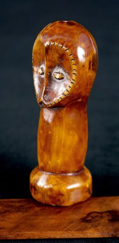 Figurine from the Lega people of DR Congo. Ivory. Concave, heart-shaped facial structure.  Ivory. Honey colored, shiny patina.  From The Ulrich Klever African Art Collection