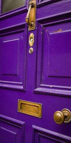 Purple door in Cahersiveen By Robin's Nest3 via Flickr.