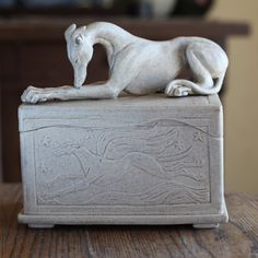 speckled box with greyhound on top....I should get one of these for my Freddie